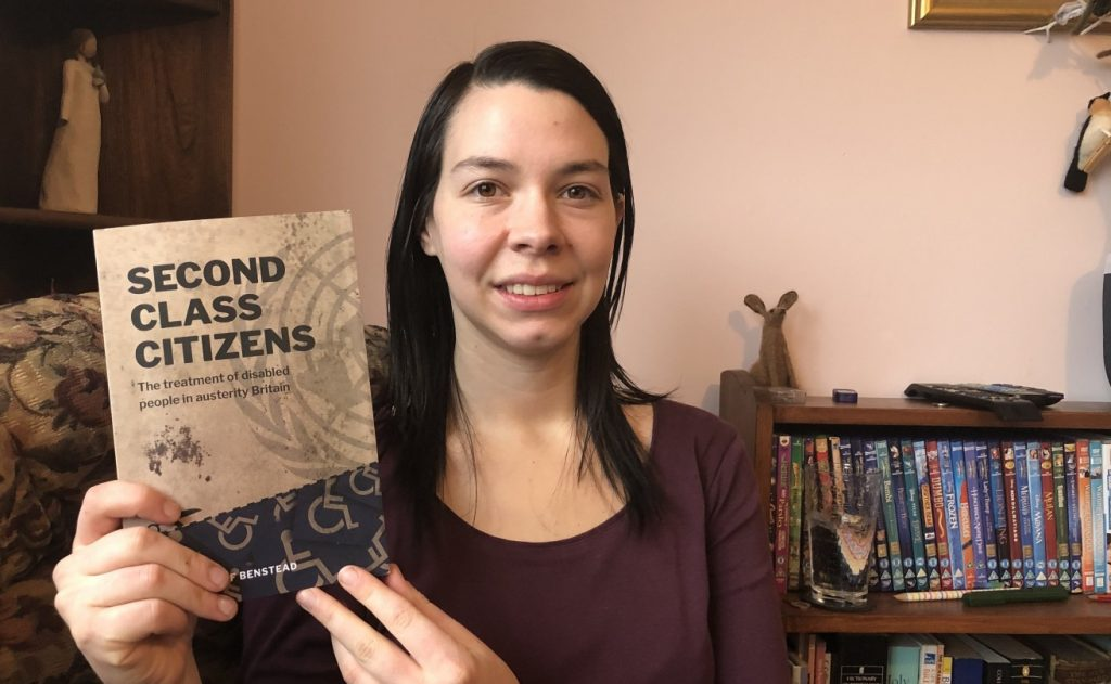 Stef Benstead with a copy her book, Second Class Citizens, which looks at the way the UK has breached disabled people's human rights