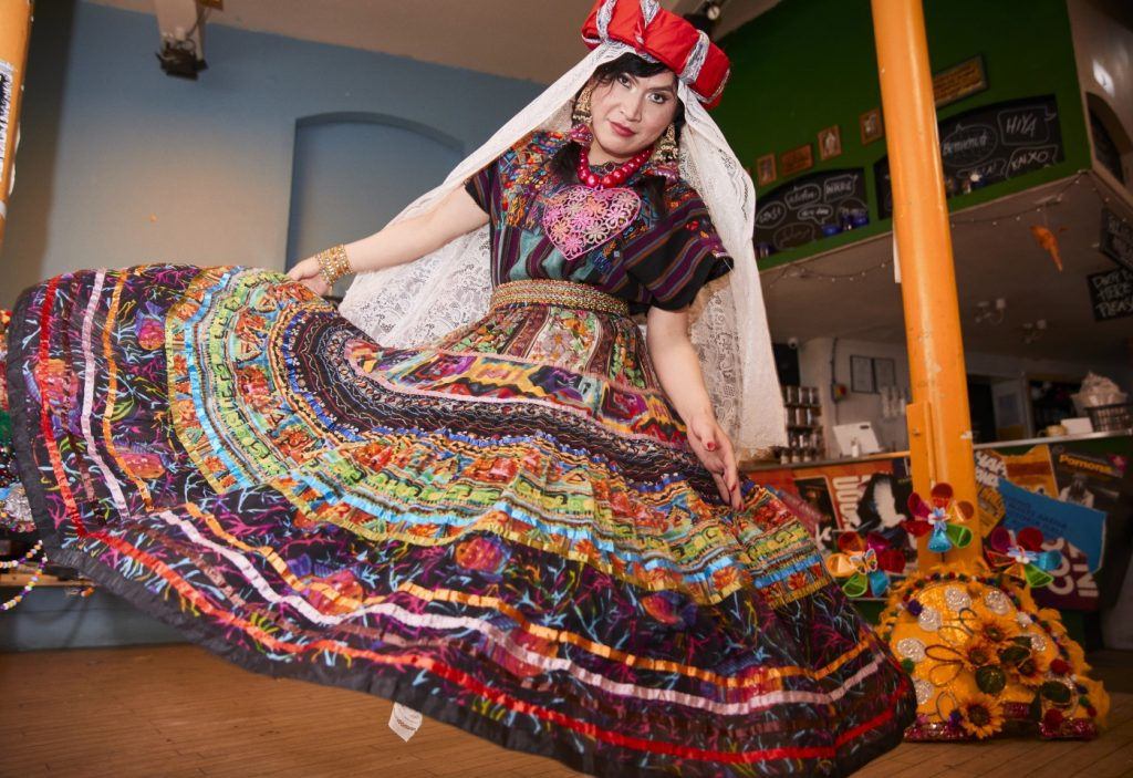 Sally from Migrant Support in decorative dress