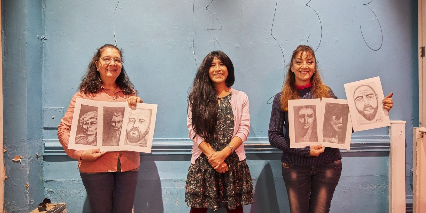Volunteers with art at Migrant Support