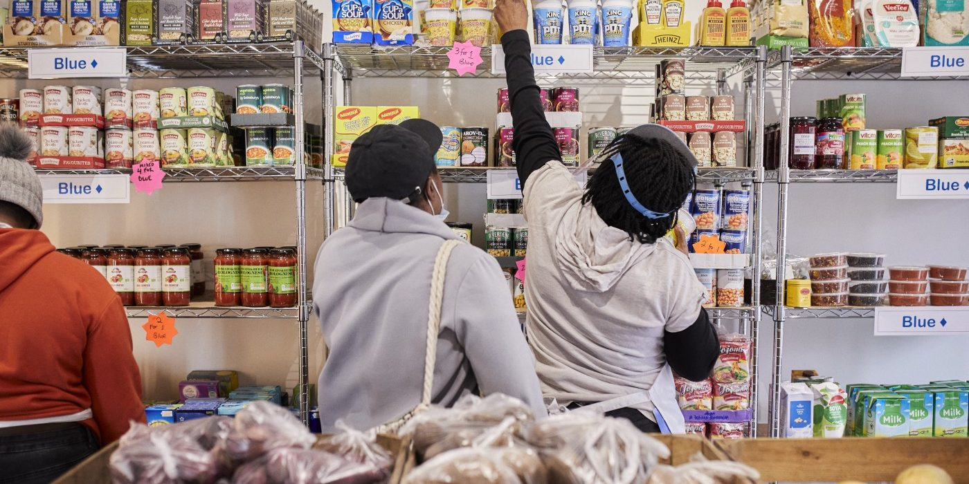 A volunteer and a customer at the Peckham Your Local Pantry