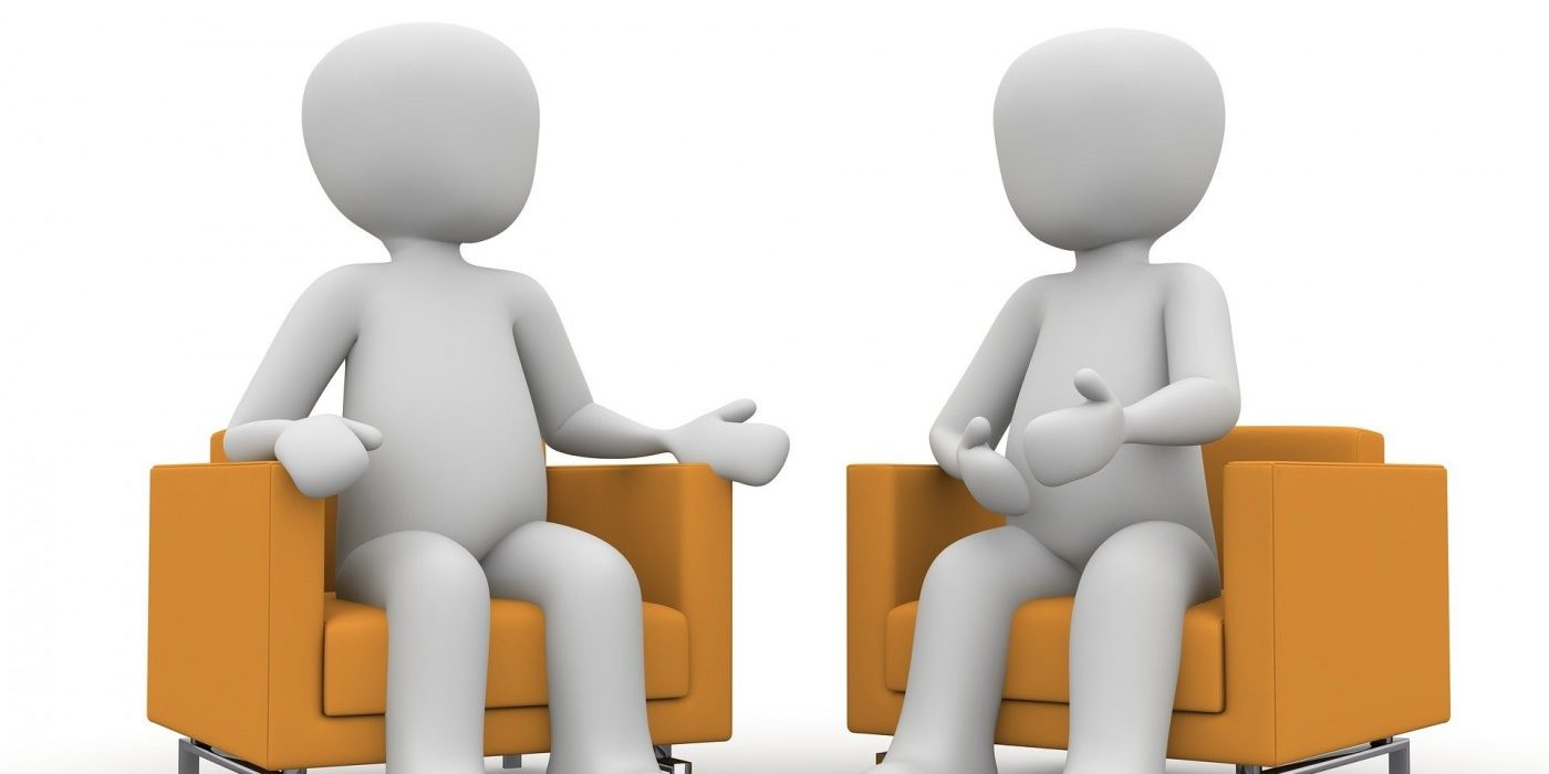 stock cartoon image of two people sitting in adjacent chairs, talking